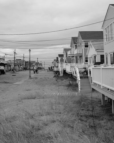 New England Beach Houses in the Winter Connecticut New England  Winter Architecture Beach Beach Houses  Building Exterior Built Structure Cable Day Grass Outdoors Sky Water