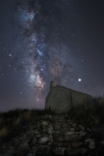 Milky way on ancient church with natural stairs in direction of sky near gallipoli in italy