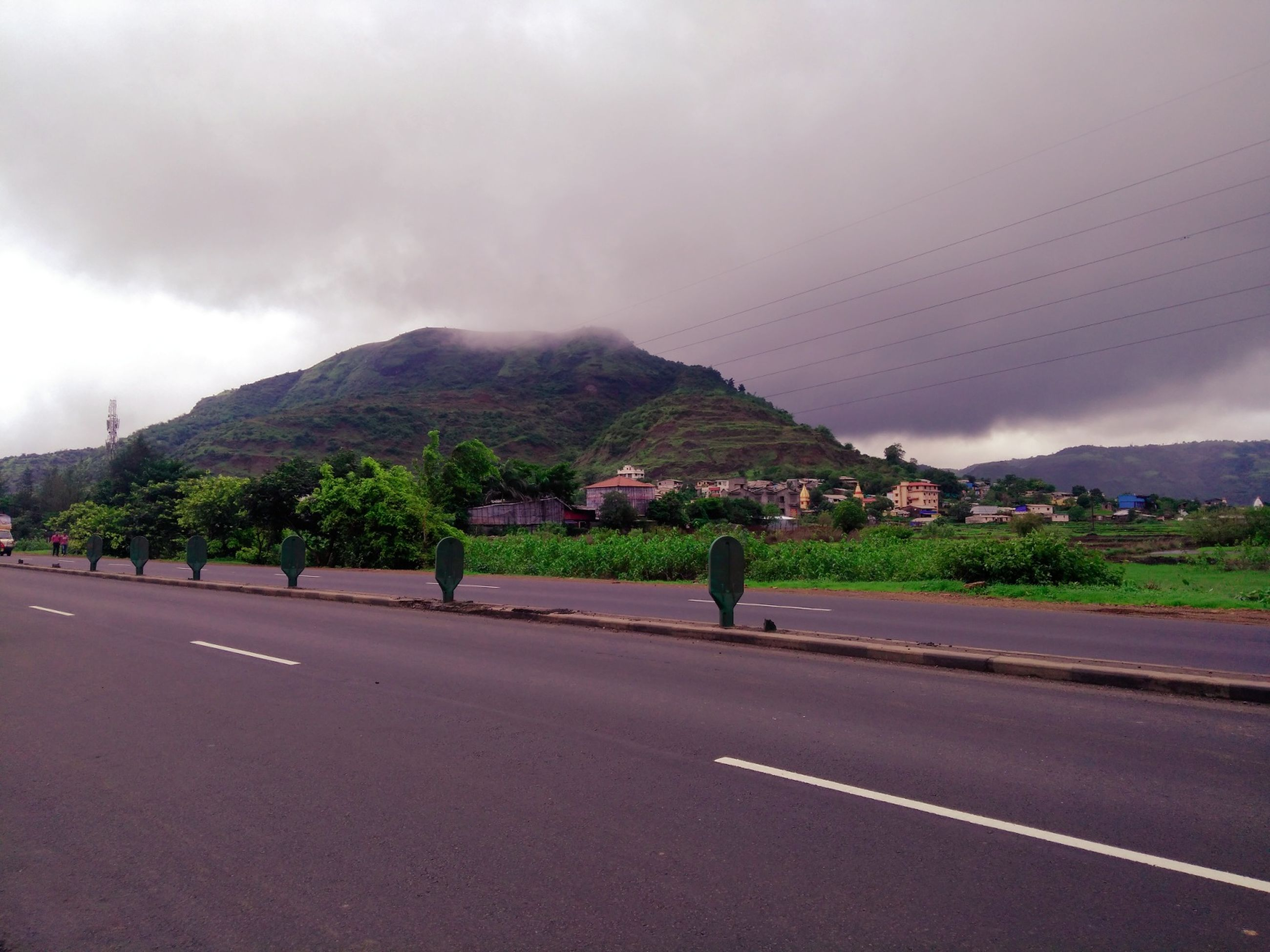 mountain, road, transportation, sky, outdoors, nature, cloud - sky, mountain range, day, real people, scenics, the way forward, landscape, men, beauty in nature, tree, people