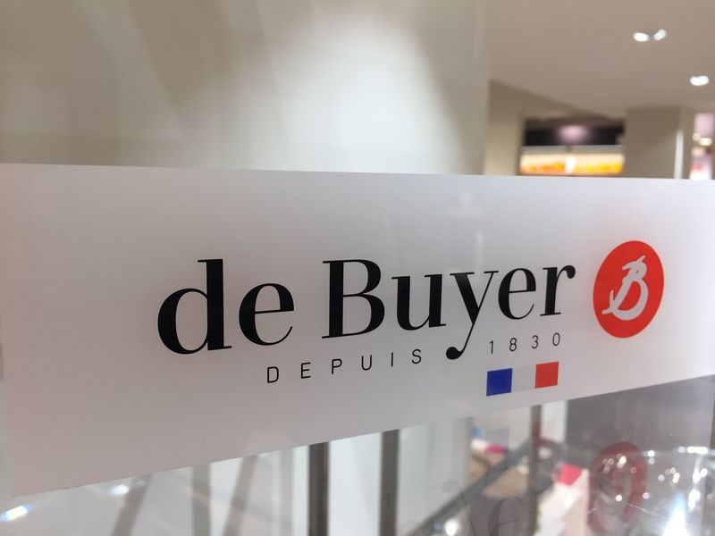 Berlin, Germany - January 27, 2018: De Buyer logo. De Buyer is a French cookware manufacturer, founded in 1830, from the village Le Val-d'Ajol in the Vosges department Company Cooking Kids Logo Close-up Communication Cookware Editorial  Focus On Foreground French Indoors  Kitchen Ware Manufacturer No People Text Utensils