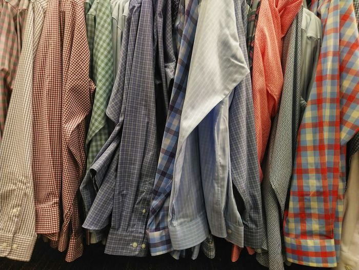Full frame shot of multi colored shirts hanging on rack