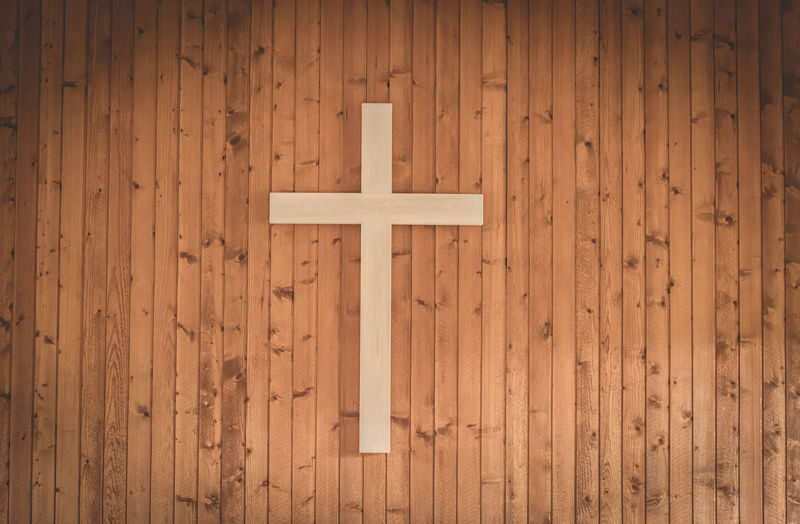 Close-up of cross on wooden wall