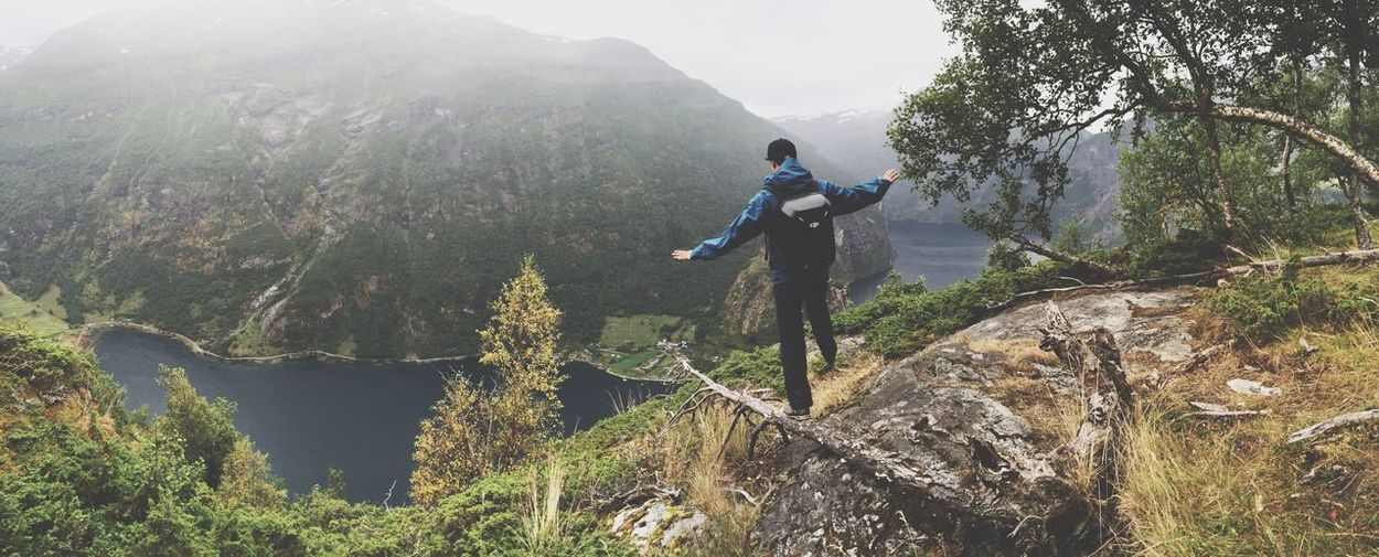 Finding New Frontiers Above the Fjords of Norway Mountain Nature Beauty In Nature Adventure Leisure Activity Scenics Lifestyles One Person Mountain Range Recreational Pursuit Real People Tree Sport Men Outdoors Rock - Object Landscape Tranquility Full Length Vacations