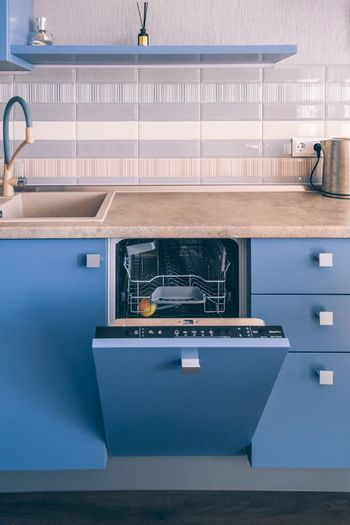 Kitchen interior design and opened dishwasher machine