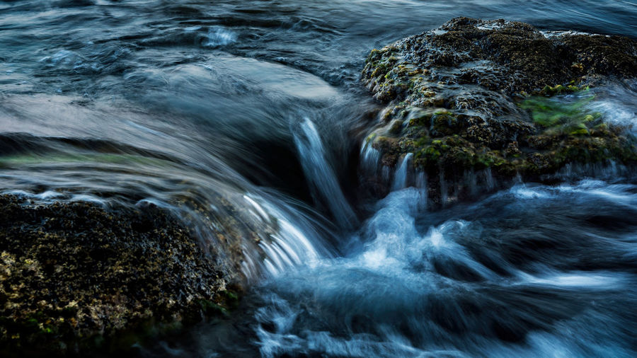 Aquatic Sport Beauty In Nature Blurred Motion Day Flowing Flowing Water Land Long Exposure Motion Nature No People Outdoors Power In Nature Rock Rock - Object Scenics - Nature Sea Solid Sport Water Waterfall