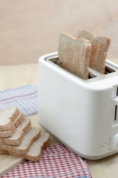 Copy Space Loaf Of Bread Bread Breakfast Close-up Day Food Food And Drink Freshness Healthy Eating Indoors  No People SLICE Table Toasted Bread Toaster Whole Wheat Wood - Material