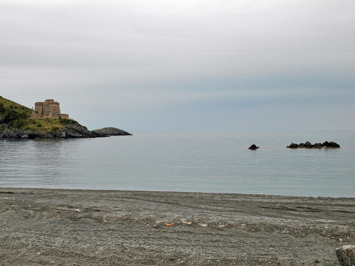 Beach with a view of the coastal tower of San Nicola Arcella South Italy Architecture Beach Beauty In Nature Built Structure Calabria Coast Coast Tower Coastal Tower Gray Day Horizon Over Water Outdoors Rock - Object Rocks And Sea Rocks In Water San Nicola Arcella Scenics Sea Sea And Sky Tower Tranquil Scene Tranquility Travel Destinations Travel Destinaton Waterfront