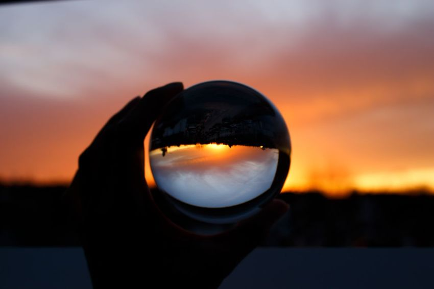 Perspective. Beauty In Nature Camera - Photographic Equipment Close-up Crystal Ball Day Focus On Foreground Human Body Part Lens Ball Nature One Man Only One Person Orange Color Outdoors People Photography Themes Scenics Silhouette Sky Sunset EyeEmNewHere