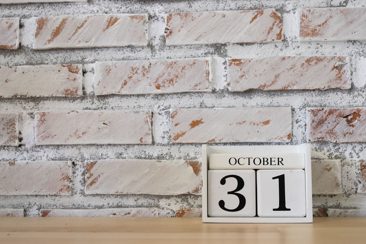 October 31th. Image of October 31 wooden color calendar white brick wall background. Autumn day. Empty space for text 31october Architecture Autumn Brick Wall Built Structure Calendrier Communication Day Geometric Shape October October Sweet October! Outdoors Text Wall - Building Feature Western Script