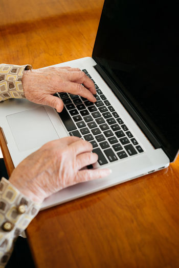 High angle view of man using laptop on table