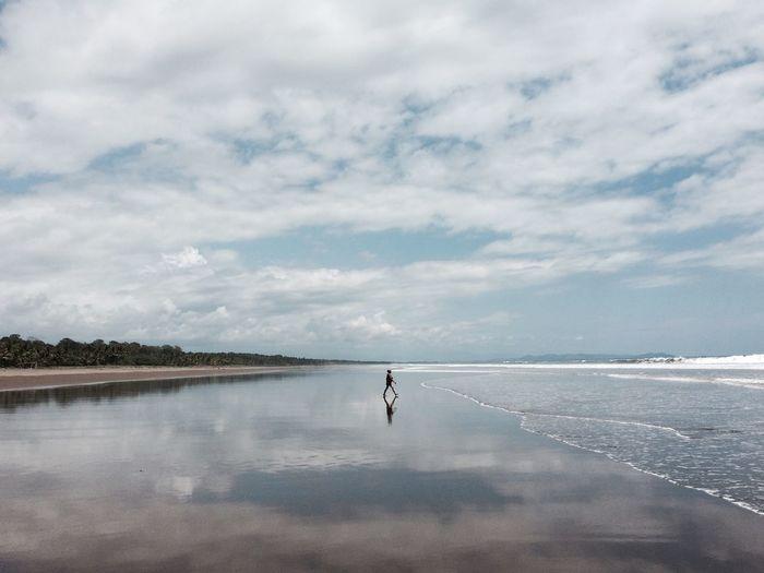 Side View Of Man Walking At Beach