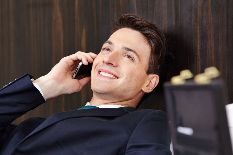 Portrait of smiling man using mobile phone