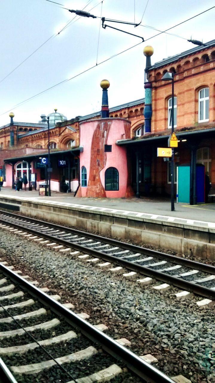 railroad track, building exterior, built structure, architecture, transportation, rail transportation, cable, sky, outdoors, no people, public transportation, day