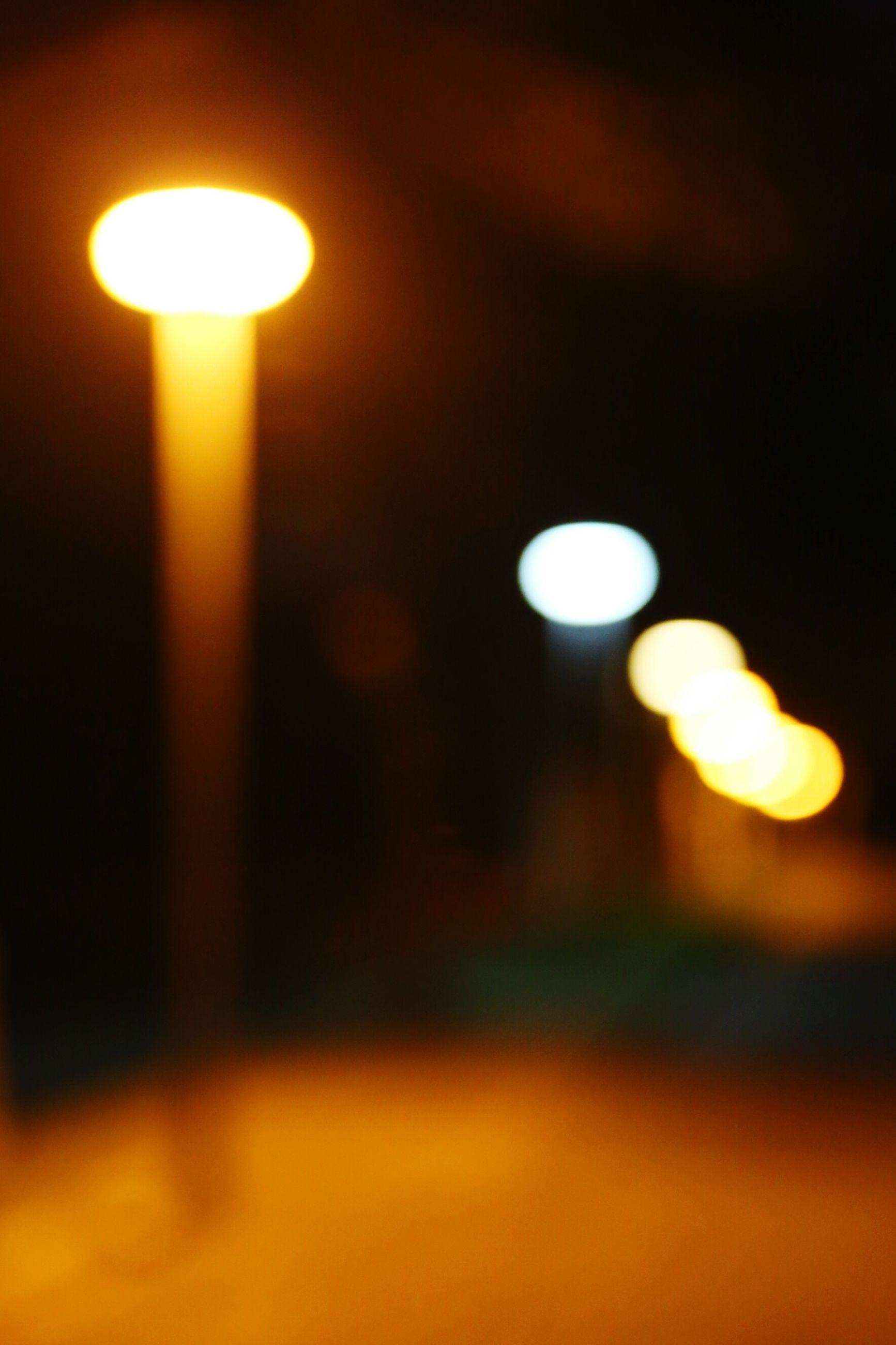 illuminated, night, lighting equipment, glowing, defocused, light - natural phenomenon, electricity, electric light, lens flare, street light, light, circle, dark, lit, moon, no people, orange color, close-up, focus on foreground, electric lamp