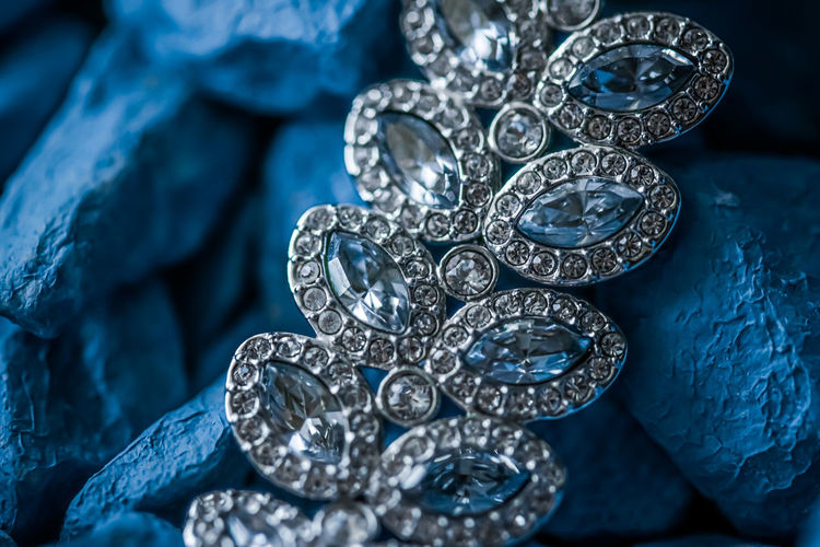 Full frame shot of jewelry on stones