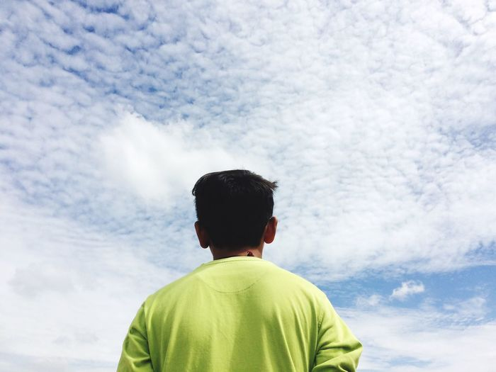 Rear view of man against sky
