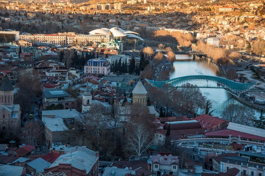Tbilisi gets colored by rosed sun Old Town Georgia Tbilisi Architecture High Angle View Winter Building Exterior Outdoors Town Travel Destinations Cityscape