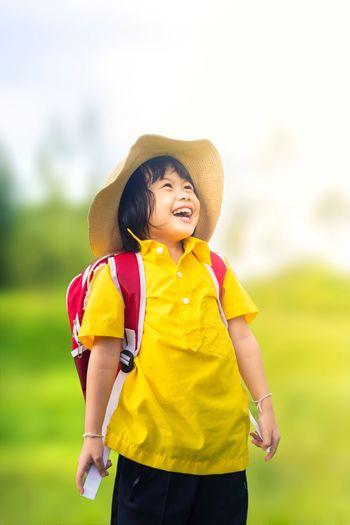 Happy Happy holidays ดีใจ ปิดเทอม เด็กหญิง Girl Childhood Hat Child Clothing One Person Offspring Nature Yellow Front View Standing Leisure Activity Innocence Preschool Age Males  Day Smiling Three Quarter Length Preschool Boys Outdoors