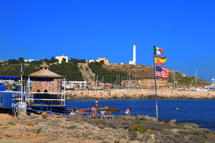 Lighthouse Architecture Beach Blue Building Exterior Built Structure Clear Sky Day Flag Italy Leuca Lighthouse_captures Nature No People Outdoors Patriotism Sea Sea And Sky Sky Summerdays  Water