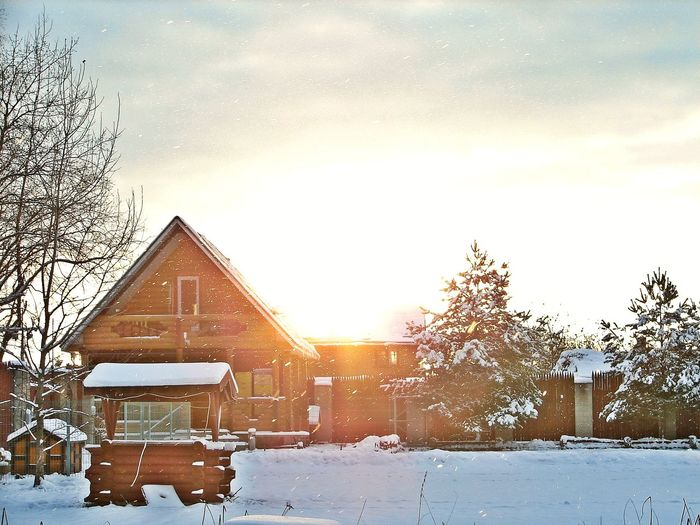 Village. Winter. Sunset. Bare Tree Cold Temperature Dramatic Sky Environment Frost Frozen No People Outdoors Sky Snow Snowing Sunset Tree Winter Wooden House In Snow