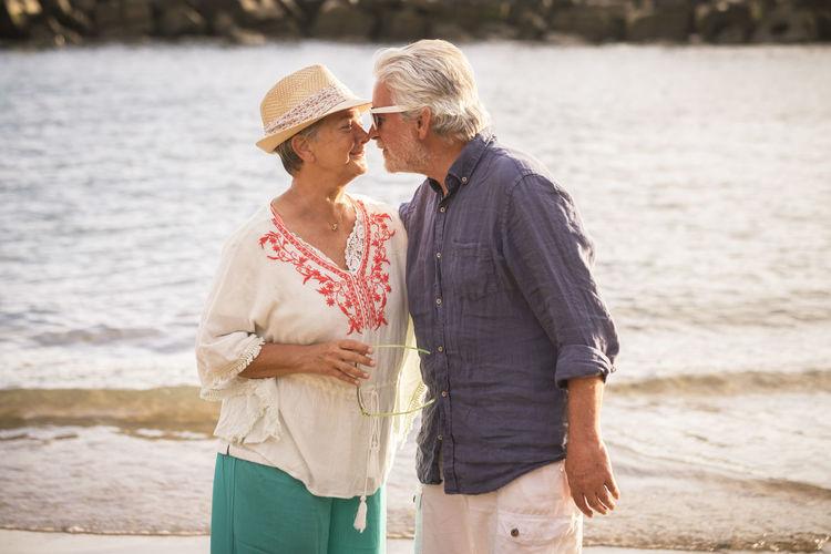 Romantic Senior Couple Standing At Beach