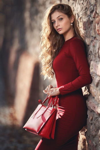 Beauty Fashion Women Beautiful Woman One Person Red Portrait Young Adult Long Hair Outdoors Dress Pretty Seductive Beautiful Attractive Caucasian Gorgeous Blonde People Bag Looking At Camera Sexygirl Autumn Curly Hair Girl International Women's Day 2019