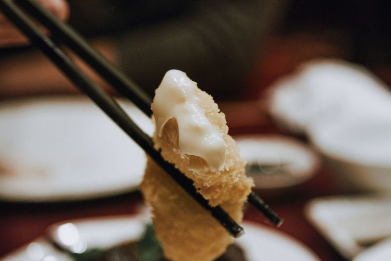 Close-up of chopsticks with food at table