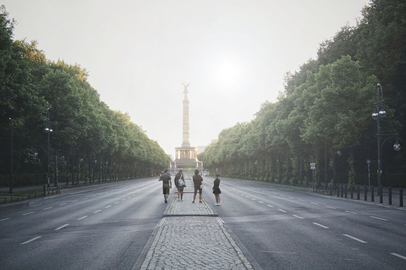 People standing on road before berlin victory column