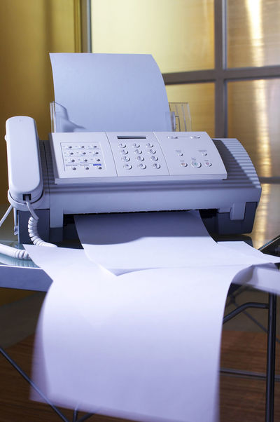 fax machine Business Fax Print Rubbish Blue Communication Connection Display Document Equipment Fax Machine Faxing  History No People Office Use Outdated Outdated Tech Phone Receiver Table Technology Telecommunications Equipment