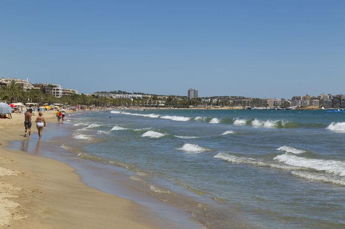 Salou, Spain, Summer 2016 Beach, Blue Boat Holiday Hot Lifeguard  Palm Trees People Sand Sea Shopping Sky SPAIN Sun Sun Worshipper Sunbathing Travel Umbrella Waves