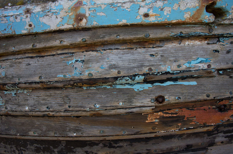 Weathered wooden boat hull detail, Blakeney, Norfolk, United Kingdom Wood - Material Weathered Full Frame Old Textured  Backgrounds Damaged Metal No People Rusty Day Close-up Decline Bad Condition Run-down Deterioration Peeling Off Pattern Abandoned Paint Ruined Boat Boat Hull Abstract