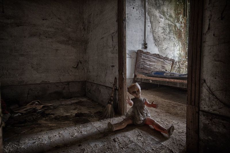 Weathered Doll In Abandoned House