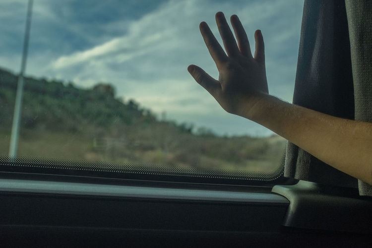 Human Hand Hand Glass - Material Window Real People Human Body Part One Person Transparent Mode Of Transportation Vehicle Interior Car Human Finger Transportation Finger Indoors  Body Part Focus On Foreground Day Motor Vehicle Human Limb Child Child Hand Business Finance And Industry Way Way To Go Home