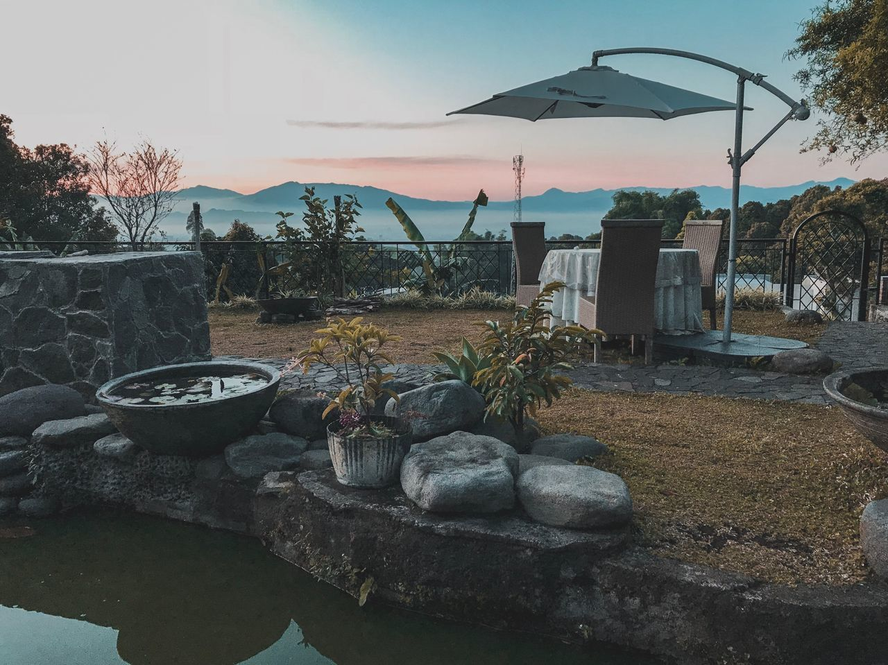 plant, sky, tree, nature, no people, solid, water, sunset, rock, day, outdoors, umbrella, land, rock - object, architecture, beauty in nature, tranquility, front or back yard