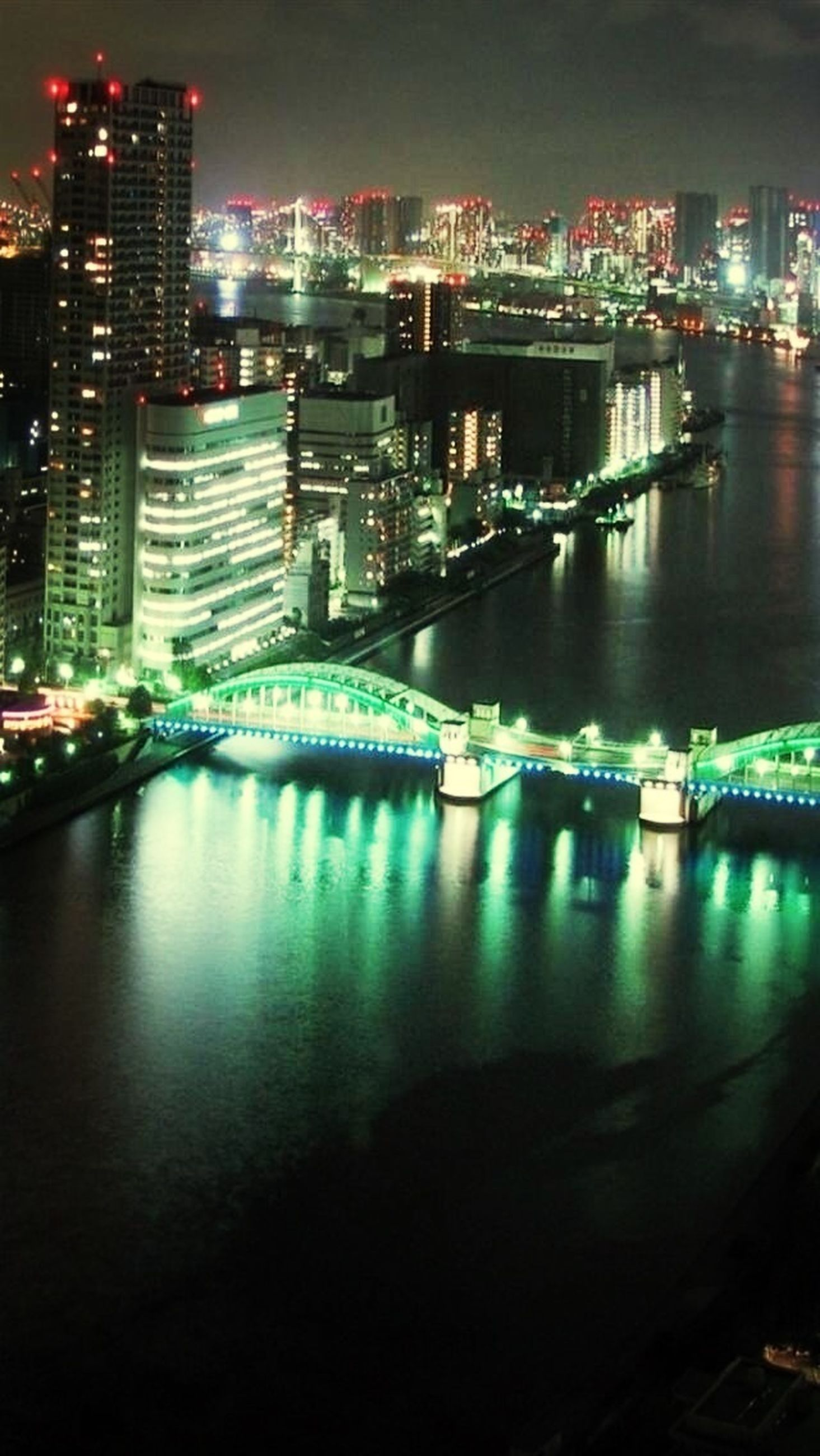 illuminated, night, architecture, built structure, building exterior, city, cityscape, water, river, waterfront, reflection, modern, skyscraper, travel destinations, city life, capital cities, residential building, light - natural phenomenon, lighting equipment, famous place