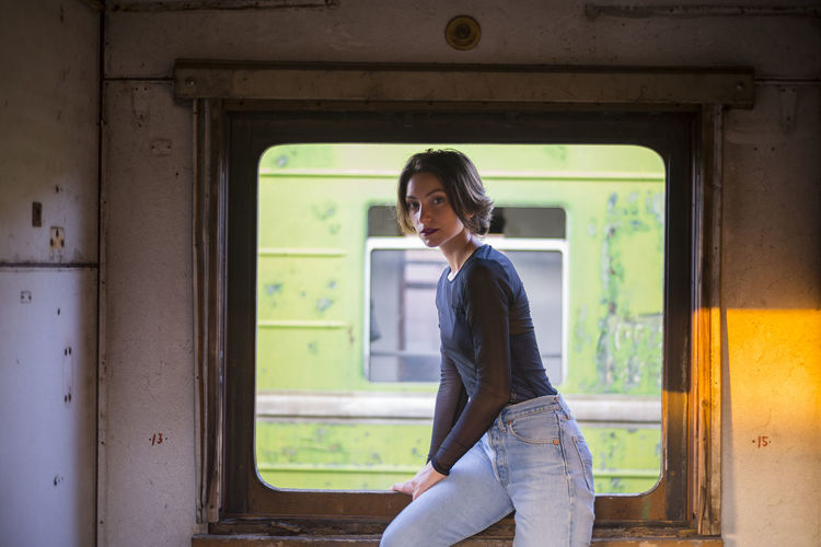Portrait Of Beautiful Woman Leaning On Window In Train
