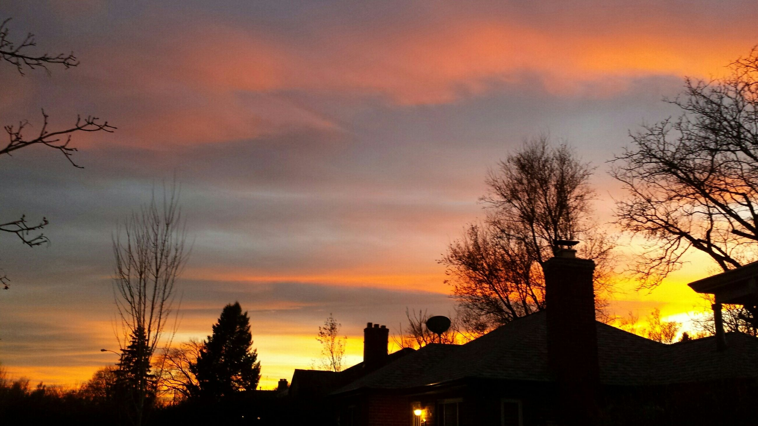 sunset, silhouette, orange color, sky, architecture, building exterior, built structure, tree, cloud - sky, low angle view, beauty in nature, bare tree, scenics, dramatic sky, nature, house, moody sky, cloud, idyllic, dusk