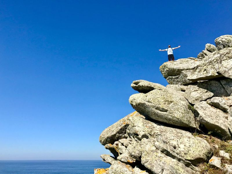 Sky Rock Rock - Object Blue Nature Solid Clear Sky Beauty In Nature Leisure Activity Water Day Real People Sunlight Land Rock Formation Copy Space Scenics - Nature Tranquility People Sea