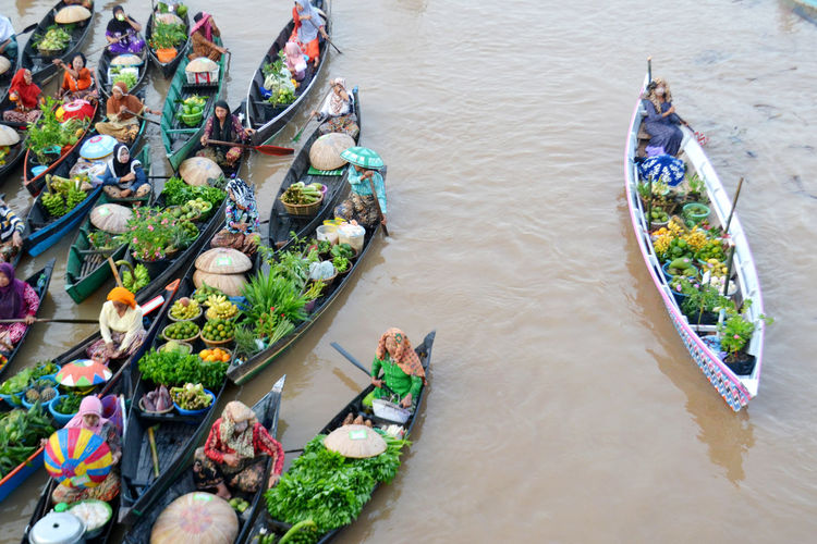 group INDONESIA Floating On Water Water Floating Floating Market Floatingmarket Market Fruit Floating In Water Human Tradition Transportation Water Nautical Vessel Gondola - Traditional Boat High Angle View River Fishing Net Stilt House Catholicism