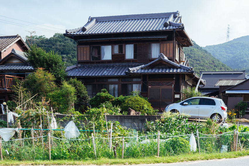 Traditional style house in Okayama Japan Japan Photography Japanese  Architecture Building Exterior Built Structure Day Grass Growth House Nature No People Outdoors Residential Building Roof Sky Tree Water