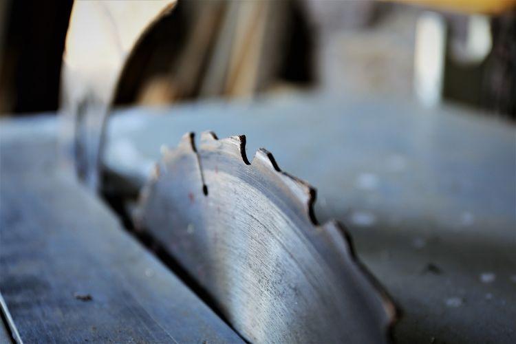 Close-up of circular saw in factory