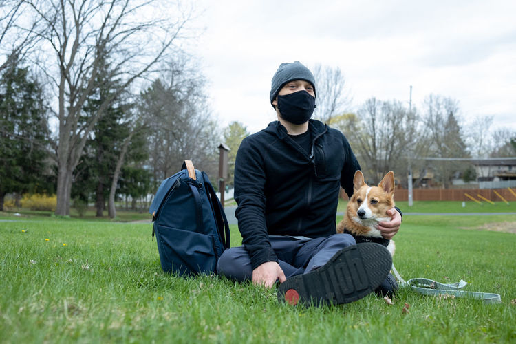 Man with dog on field