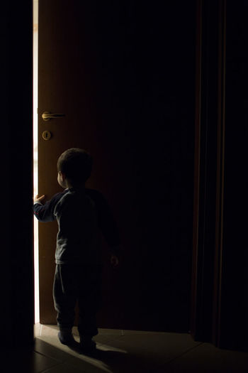 Casual Clothing Child Childhood Copy Space Dark Door Entrance Indoors  Innocence Night Offspring One Person Rear View Standing A New Beginning My Best Photo