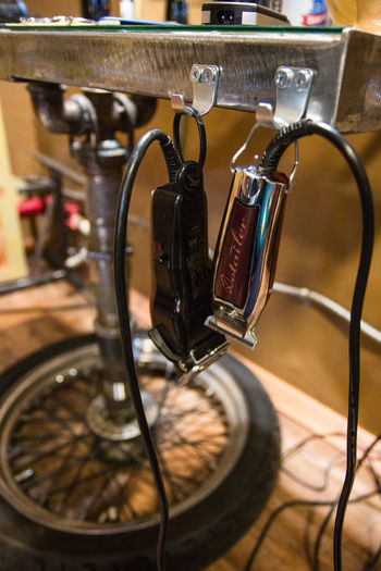 Close up of electric razors hanging on hooks at barber shop