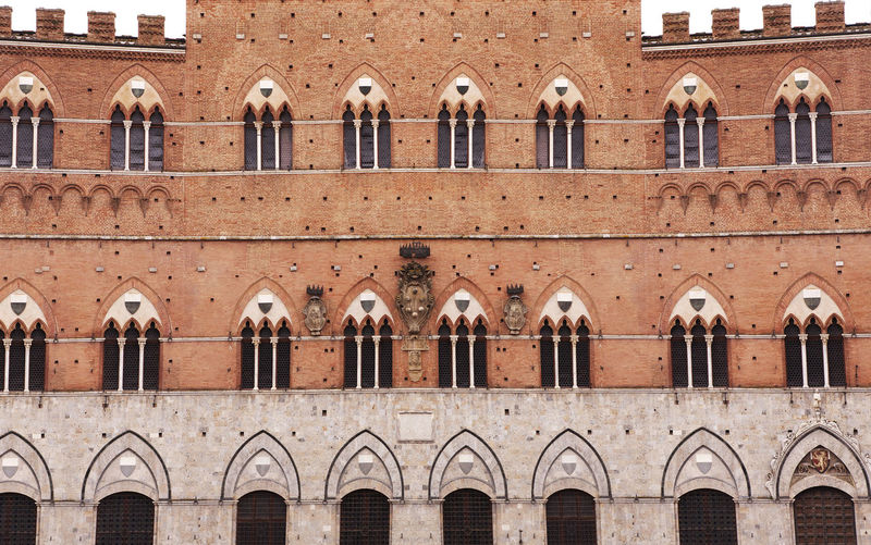 Palazzo Pubblico in Siena, Italy (facade) Siena Siena, Italy Palazzo Comunale Palazzo Pubblico Tuscany Italy City Cityscape Ancient Travel Destinations Façade Architecture Building Exterior Built Structure No People Repetition
