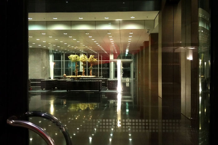 HUAWEI Photo Award: After Dark Reflection On Glass Architecture Glass - Material Illuminated Lines And Shapes Looking Through Looking Through Window Night Reflection Sitting Alone Transparent Waiting Alone Window