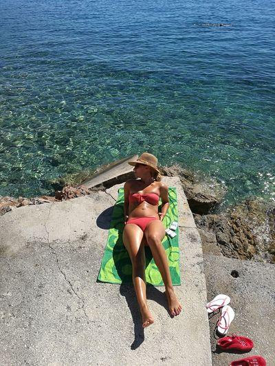 Young Woman In Bikini Resting At Beach