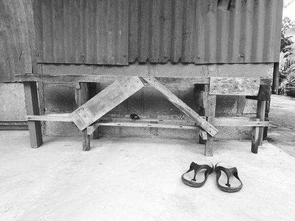 A stool and pair of shoes in black and white. Still life photo Sandal Shoes Still Life Minimalist Photography  Blackandwhite Minimalism Vintage Classic Retro Architecture Seesaw Swing Locked Pair
