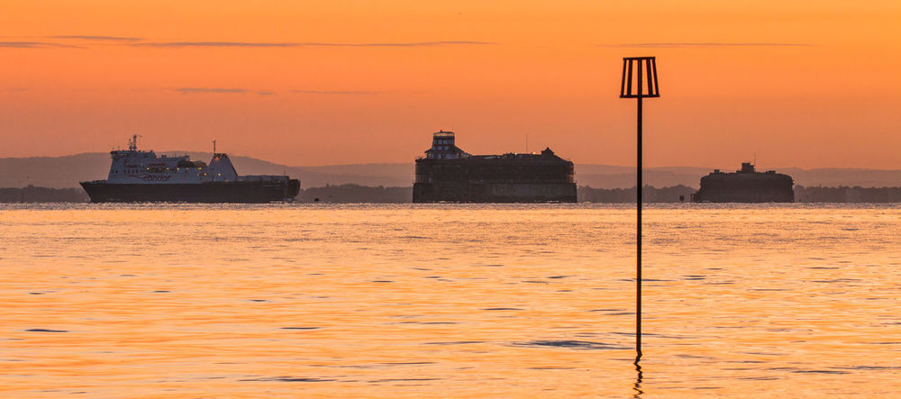 Sunrise on the Solent Architecture Beauty In Nature Building Exterior Condor Ferry Day Fort Horizon Over Water Horse Sand Fort Lighthouse Nature Nautical Vessel No Mans Fort No People Orange Color Outdoors Scenics Sea Sky Solent Solent Forts Sunrise_sunsets_aroundworld Transportation Water Waterfront