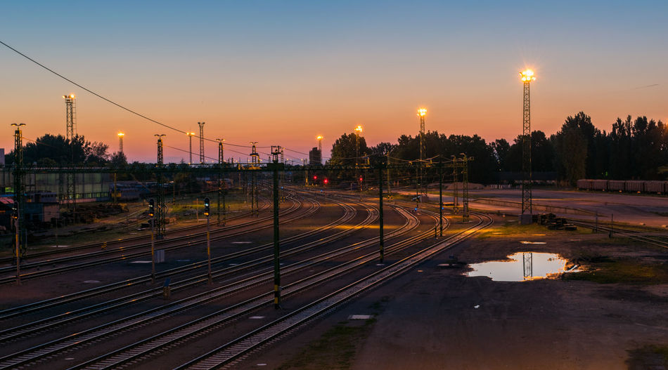 High Angle View Of Railroad Tracks Against Sky At Sunset